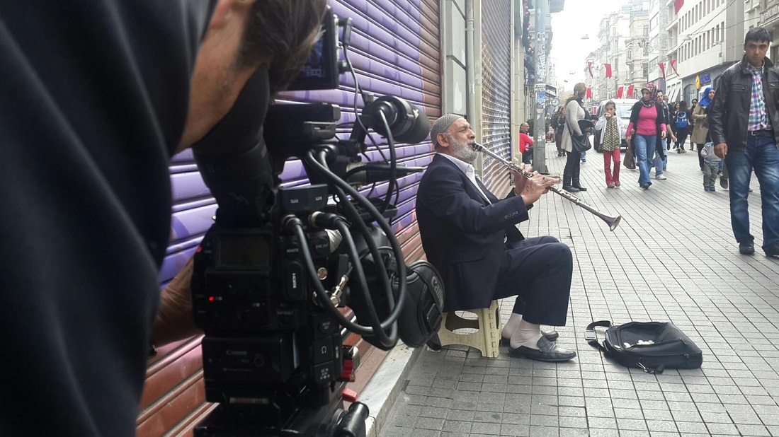 filming old street musician in istanbul